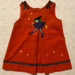 Cute Halloween dress with fun witch on a broom